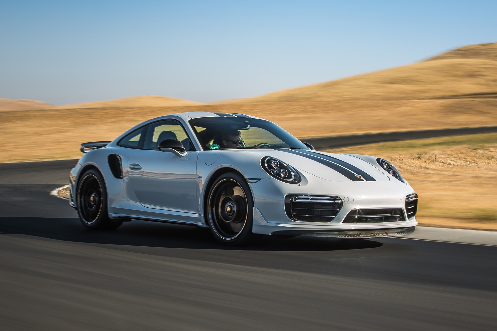 2018 Porsche 911 Turbo S Exclusive Front Three Quarter In Motion 09