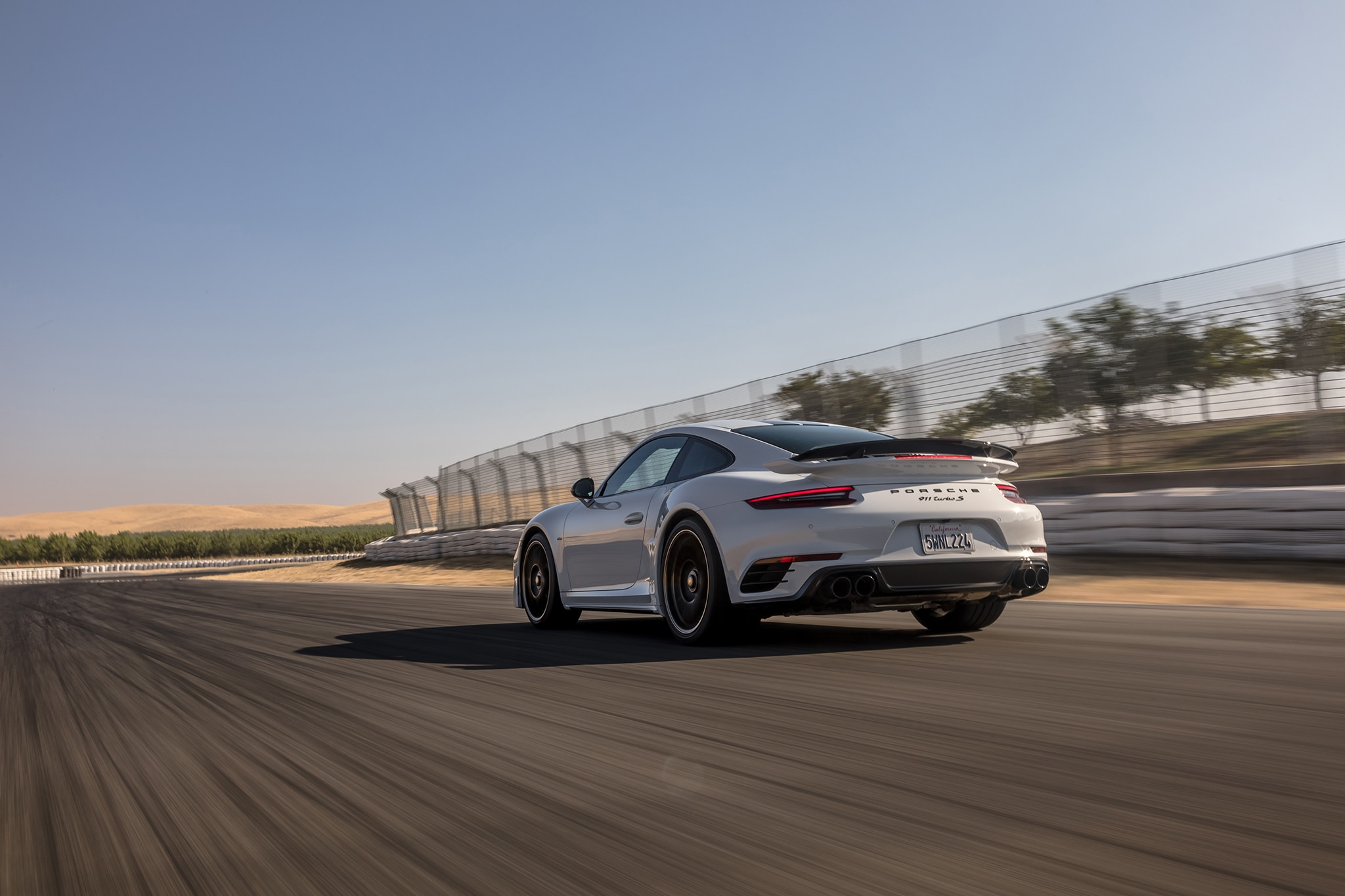 2018 Porsche 911 Turbo S Exclusive Rear Three Quarter In Motion 06