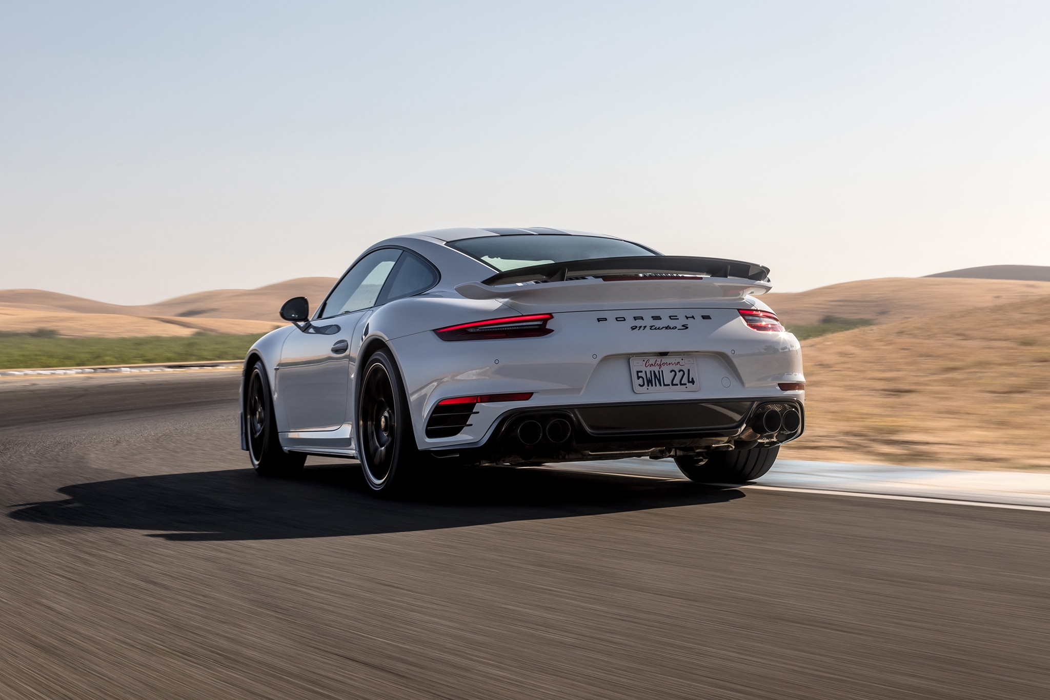 2018 Porsche 911 Turbo S Exclusive Rear Three Quarter In Motion 07