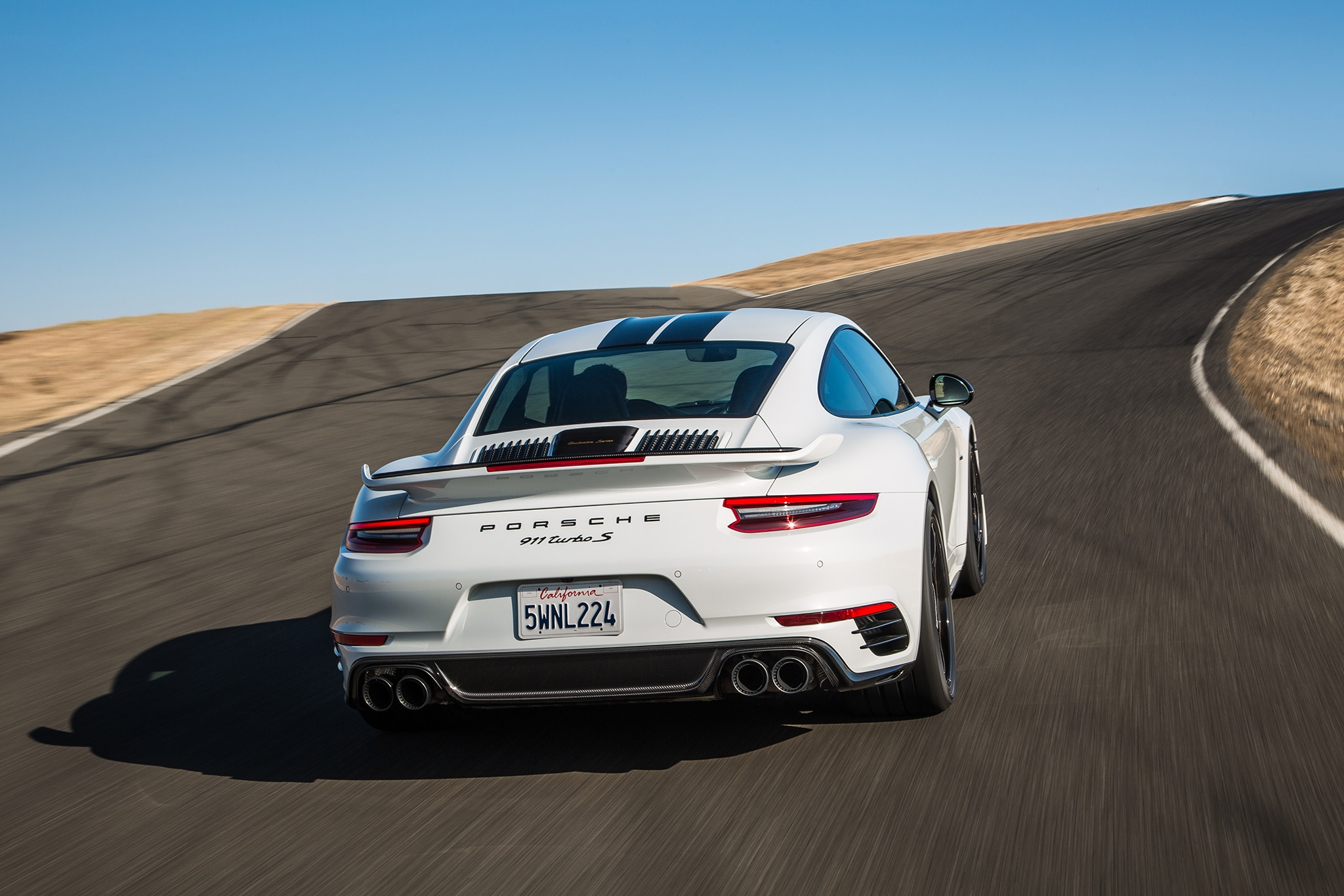 2018 Porsche 911 Turbo S Exclusive Rear View In Motion 01