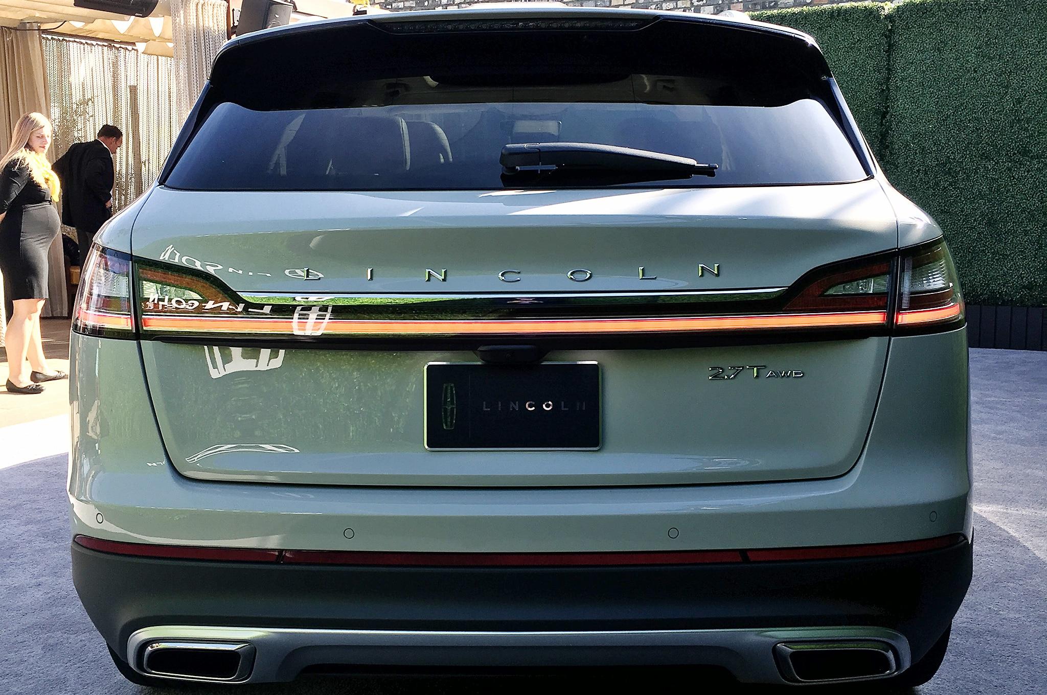 http://st.automobilemag.com/uploads/sites/11/2017/11/2019-lincoln-nautilus-live-rear-view.jpg