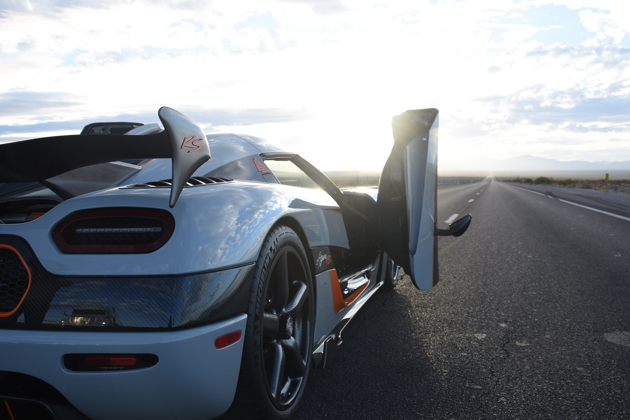 After our run down the twelve miles of Highway 160\u0027s closed test track I exited the Koenigsegg\u0027s dihedral synchro-helix doors grinning as if I had just ... & Our Exclusive Ride in an Koenigsegg Agera RS on a Closed Nevada Road ...
