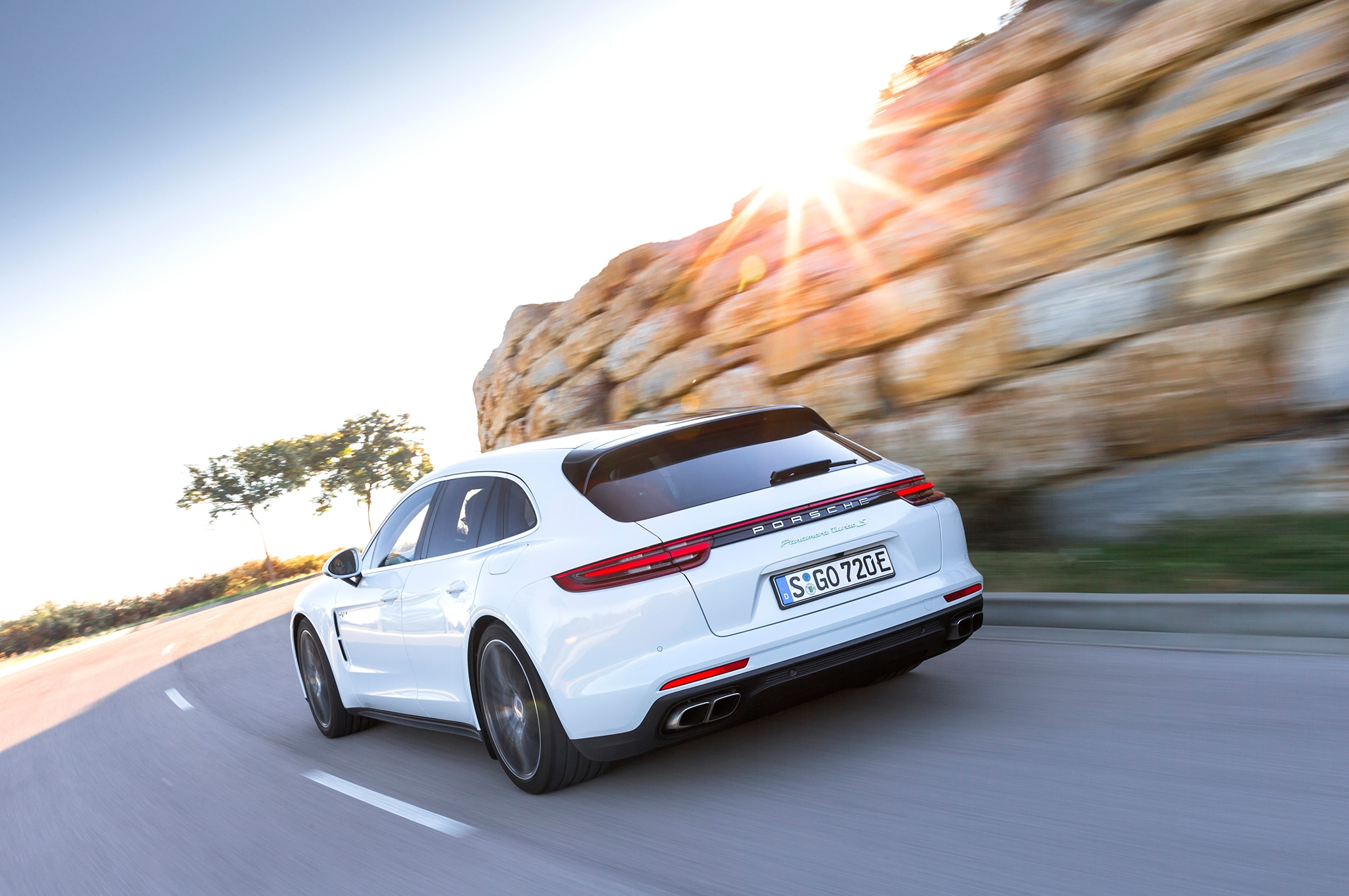 2018 Porsche Panamera Turbo S E Hybrid Sport Turismo Rear Three Quarter In Motion 04