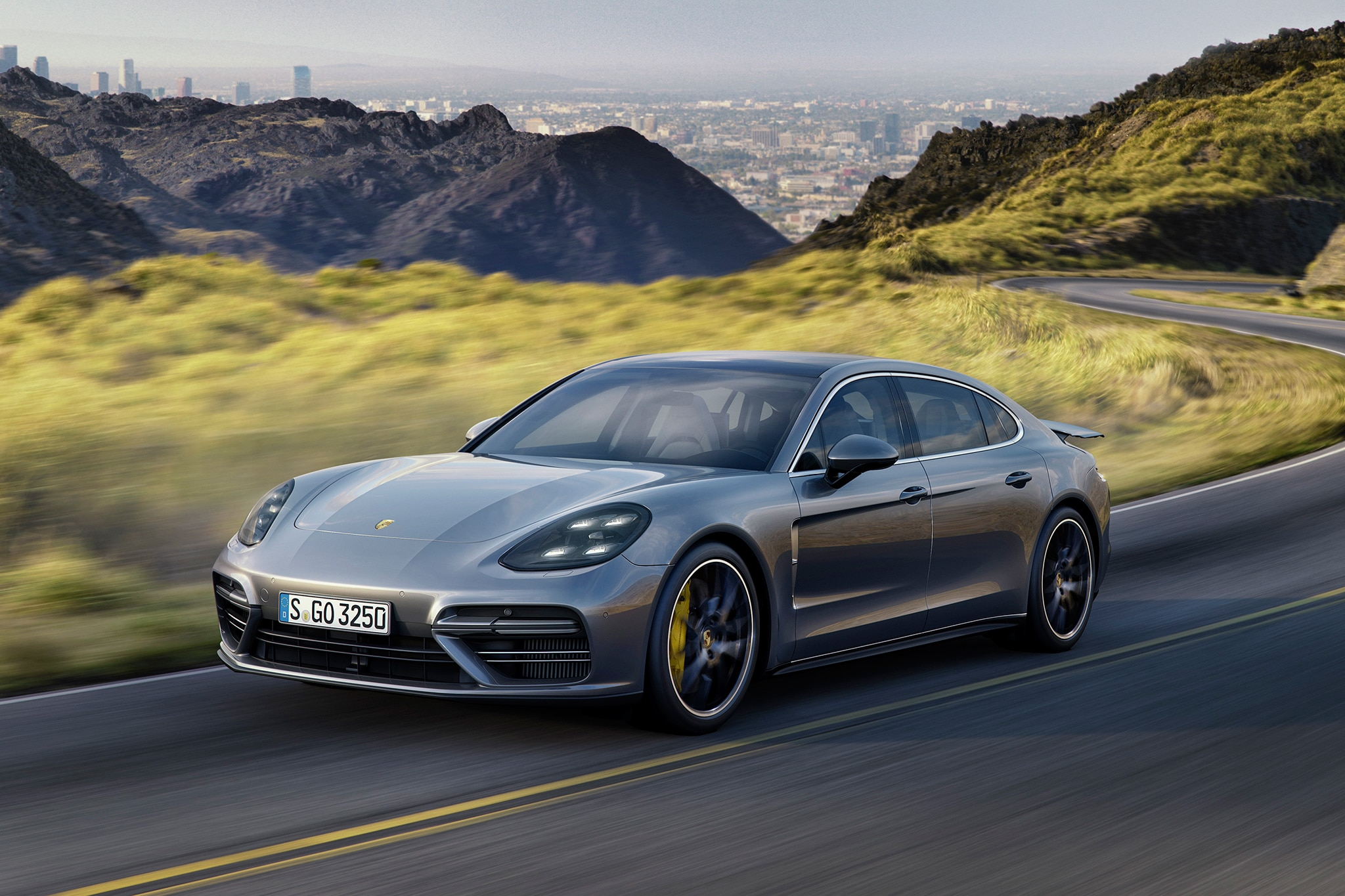 2017 Porsche Panamera Turbo Executive Front Three Quarter In Motion 01