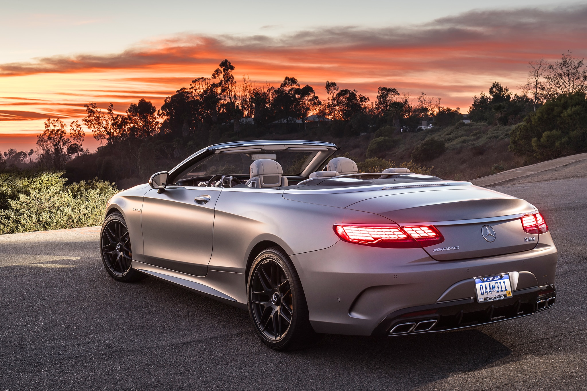 http://st.automobilemag.com/uploads/sites/11/2018/01/2018-Mercedes-AMG-S63-Cabriolet-rear-three-quarter-07.jpg