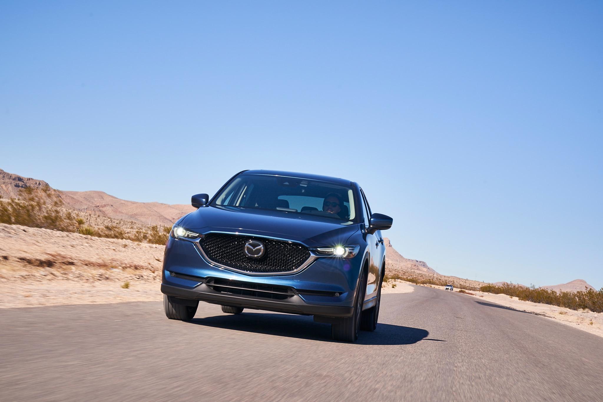 Mazda  I Grand Touring Mileage