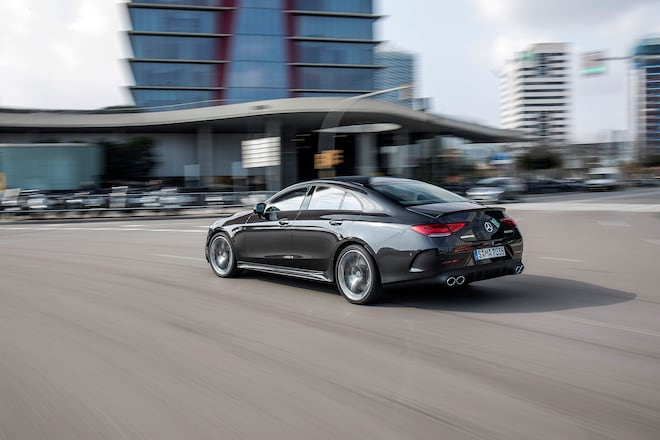 http://st.automobilemag.com/uploads/sites/11/2018/03/2019-Mercedes-AMG-CLS53-rear-three-quarter-in-motion-04.jpg?interpolation=lanczos-none&fit=around%7C660:440