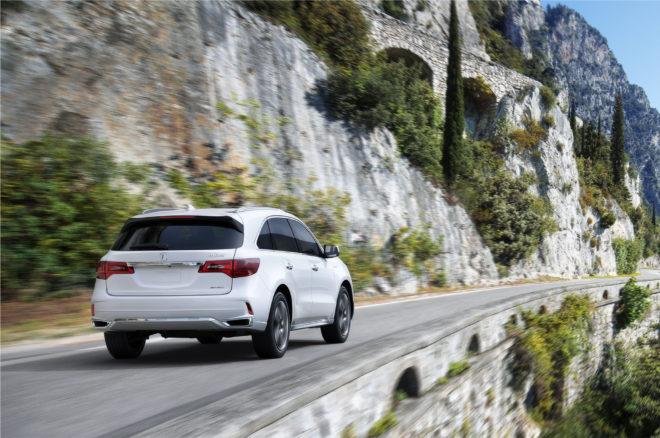 2017 Acura MDX Sport Hybrid rear three quarter in motion