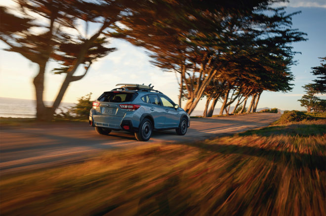 2018 Subaru Crosstrek rear three quarter in motion 01
