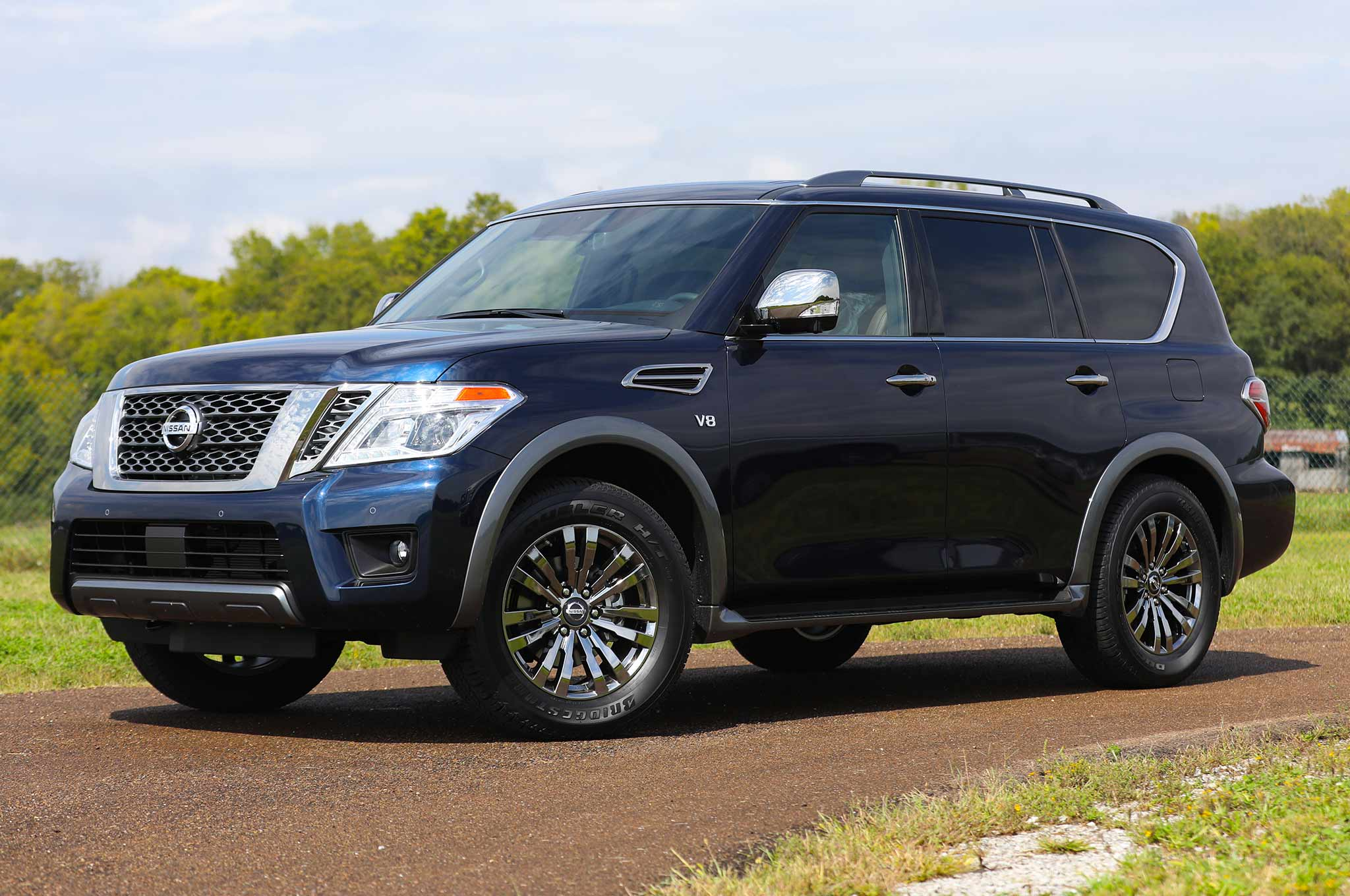 2018 Nissan Armada Platinum Reserves Debuts Texas on white door bumpers