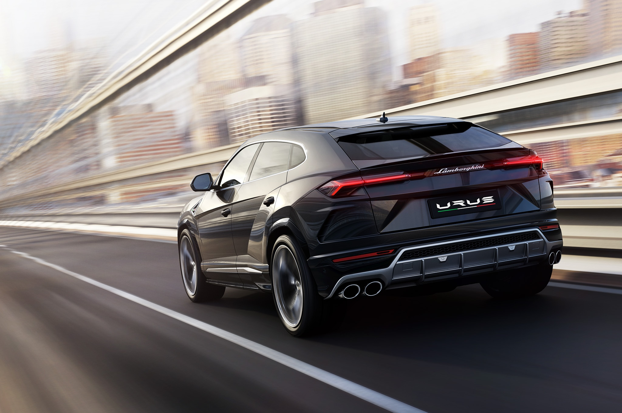 2019 Lamborghini Urus Rear Side View In Motion