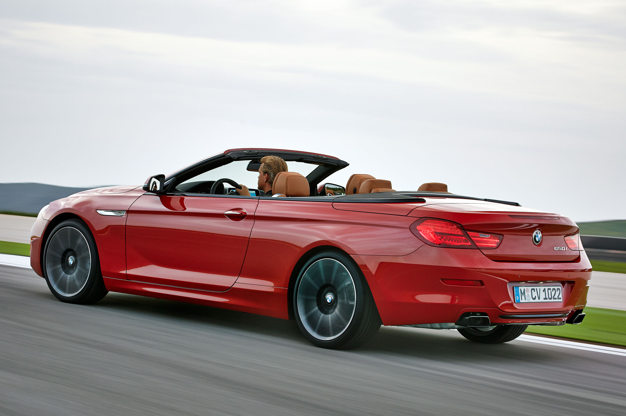 2016 Bmw 6 Series Convetible Rear Three Quarter In Motion 1