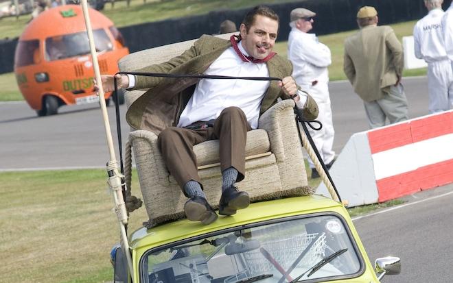 Rowan Atkinson Driving Atop A Mini1
