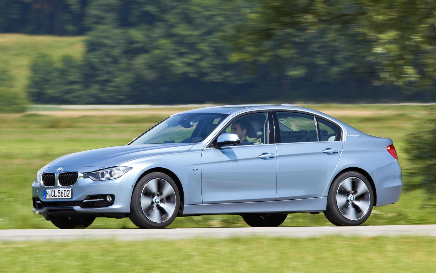 2013 BMW ActiveHybrid 3 Front View In Motion 031