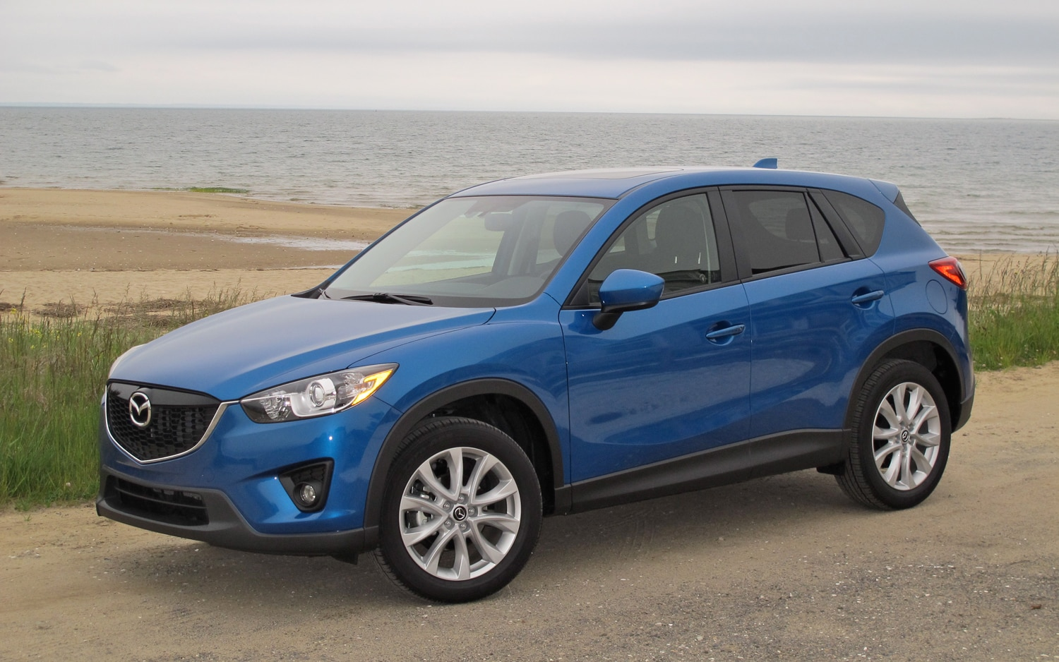https://st.automobilemag.com/uploads/sites/11/2012/07/2013-Mazda-CX-5-Grand-Touring-front-left-side-view-2.jpg