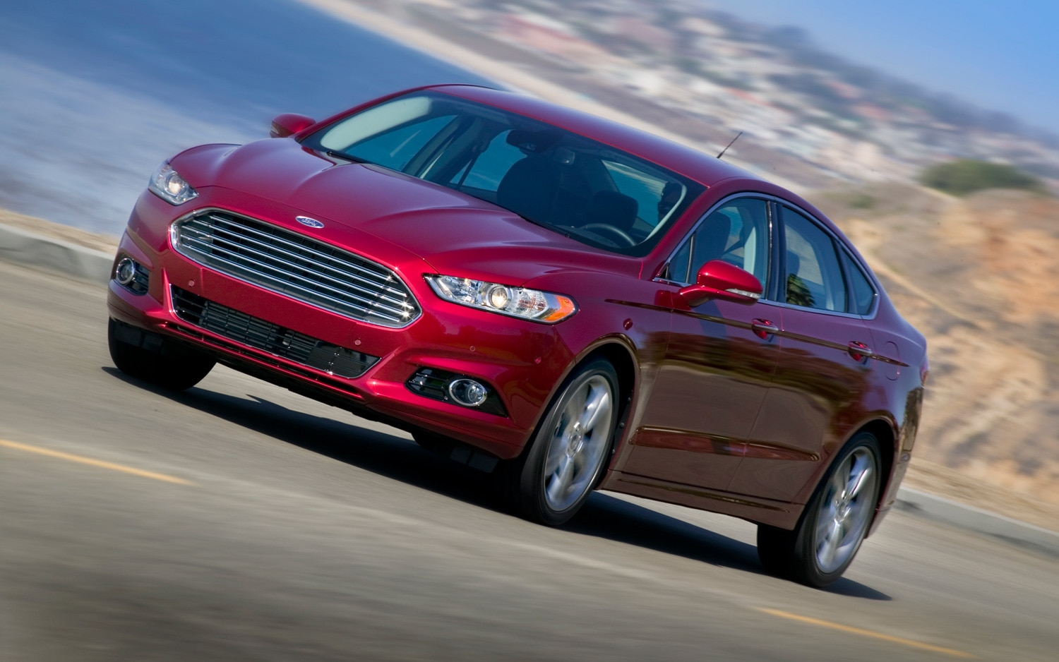 2013 Ford Fusion Titanium Front Three Quarters View In Motion