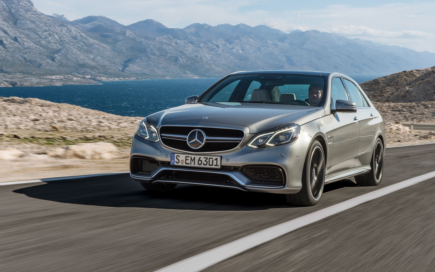 2014 Mercedes Benz E63 AMG 4MATIC Front Three Quarters In Motion1