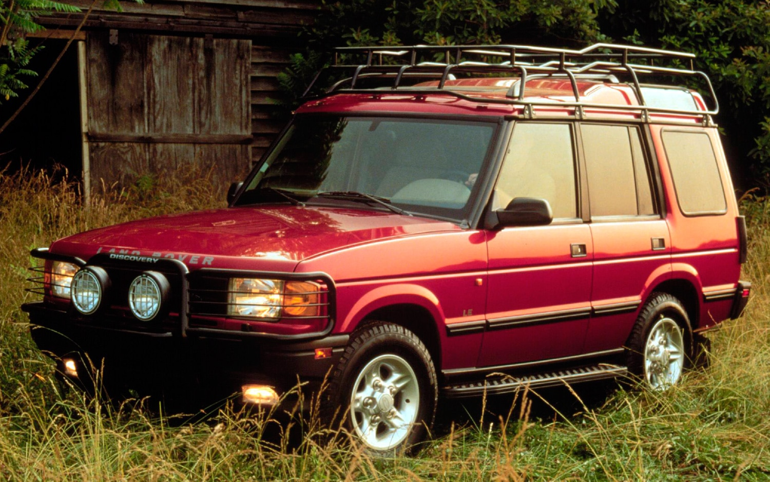 This Day In History Land Rovers 65th Anniversary Photo Gallery 1998 Rover Discovery Red Station Wagon Front Three Quarters View