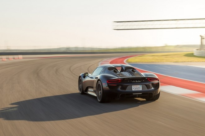 2015 Porsche 918 Spyder rear three quarter in motion1