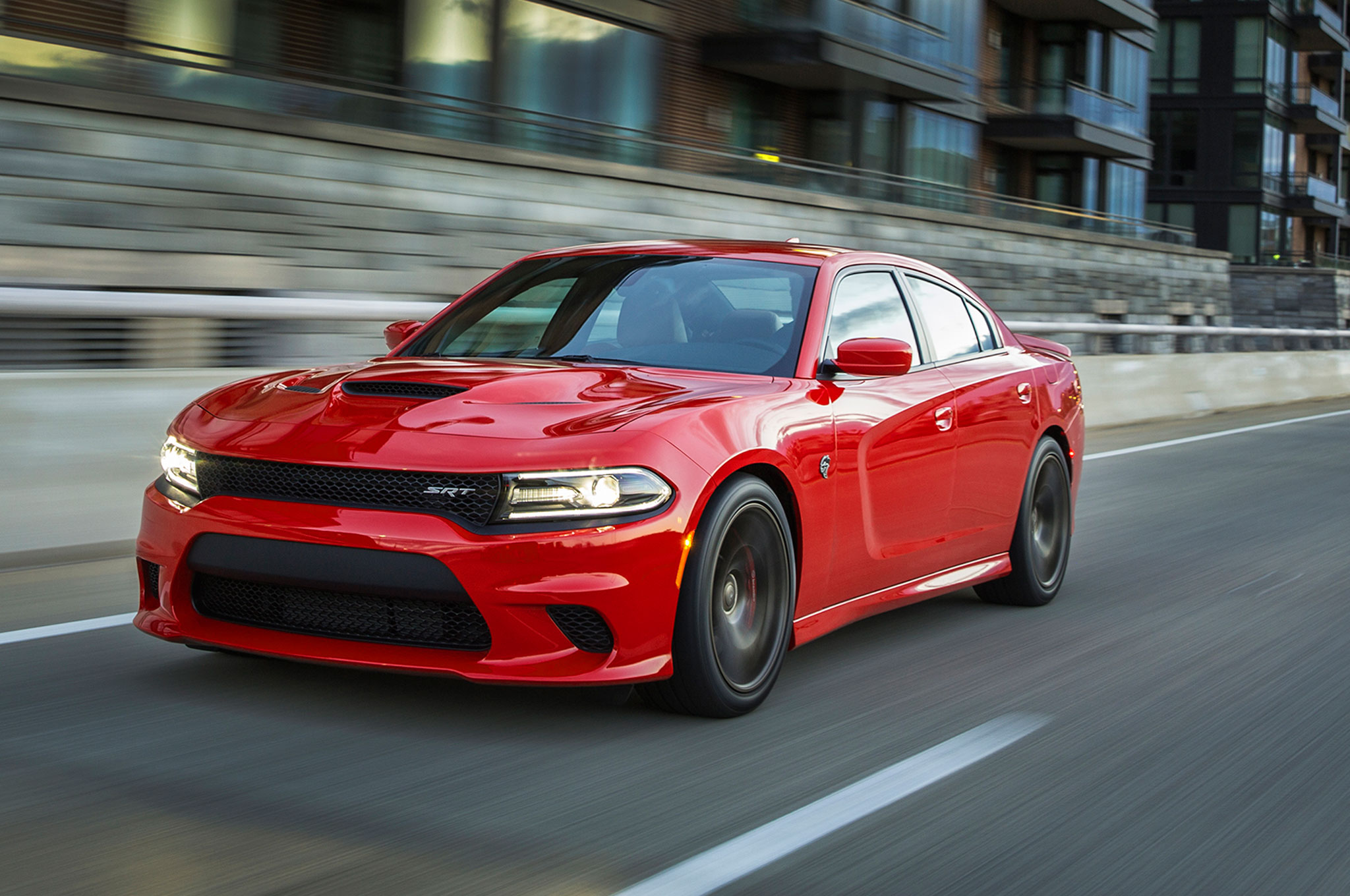2015 Dodge Charger SRT Hellcat Front Three Quarter View In Motion 7