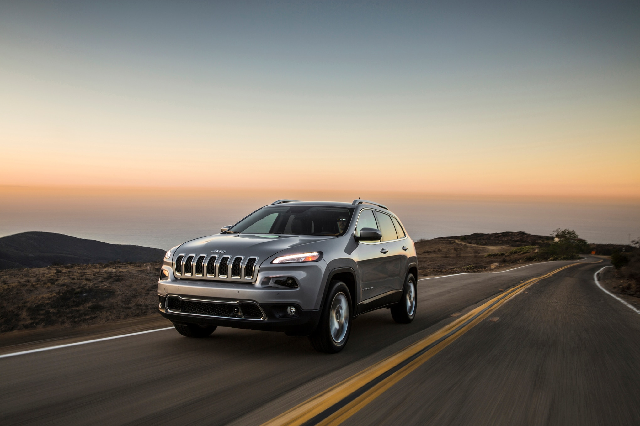 2015 Jeep Cherokee Limited Front Three Quarters In Motion 031