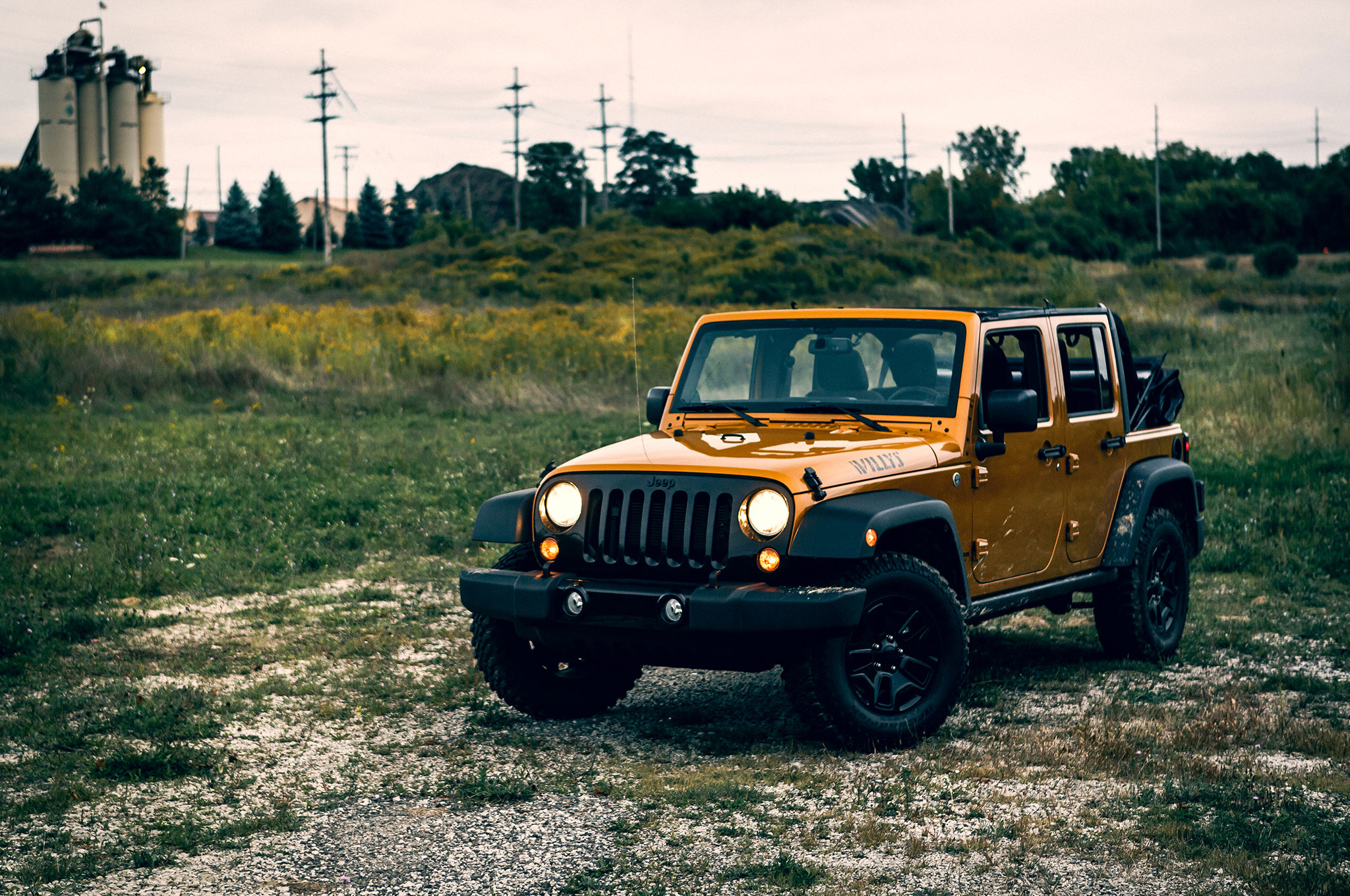 2014 Jeep Wrangler Unlimited Willys Wheeler Front Three Quarter View 2