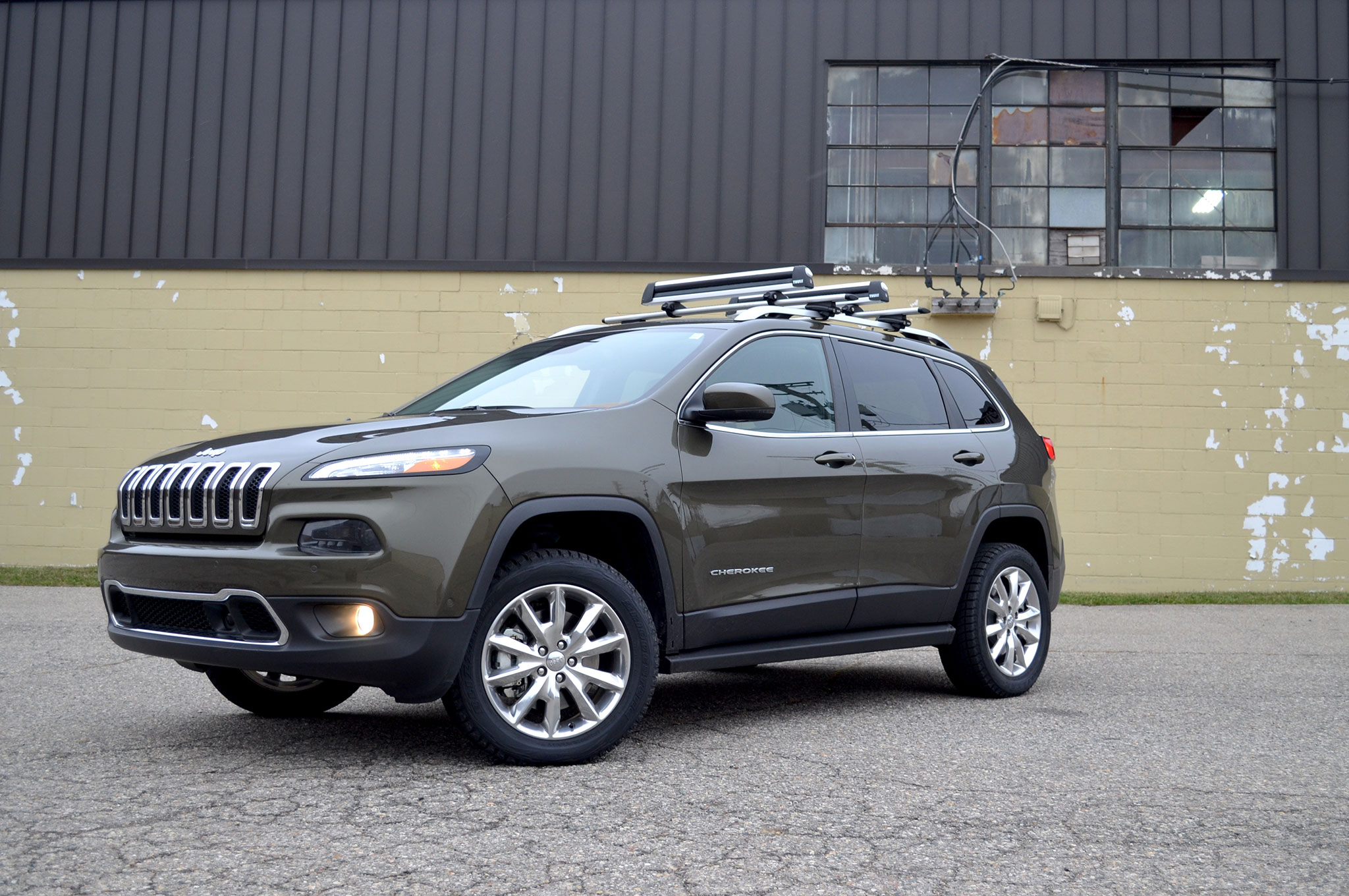 2014 Jeep Cherokee Front Three Quarter With Racks Wide Crop