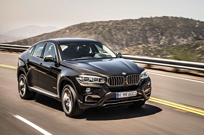 2015 BMW X6 XDrive50i Front Three Quarter In Motion 2