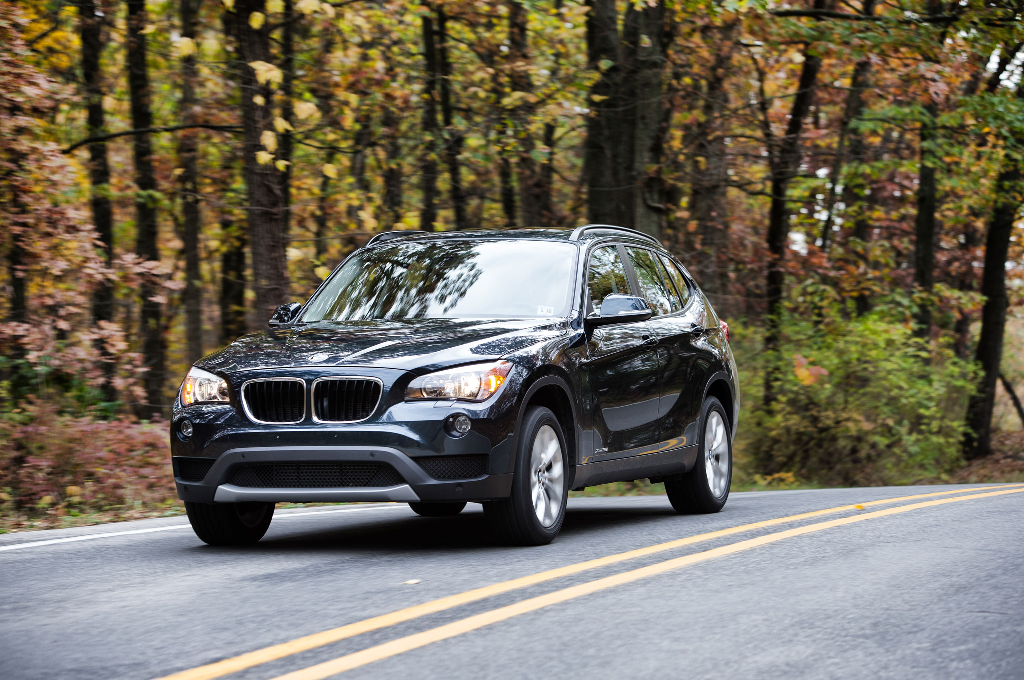 2014 BMW X1 XDrive 28i Front Three Quarter In Motion 11