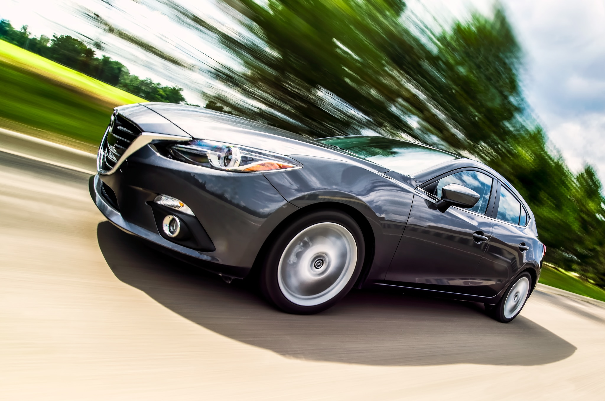 2014 Mazda 3 S Touring Front Three Quarter In Motion