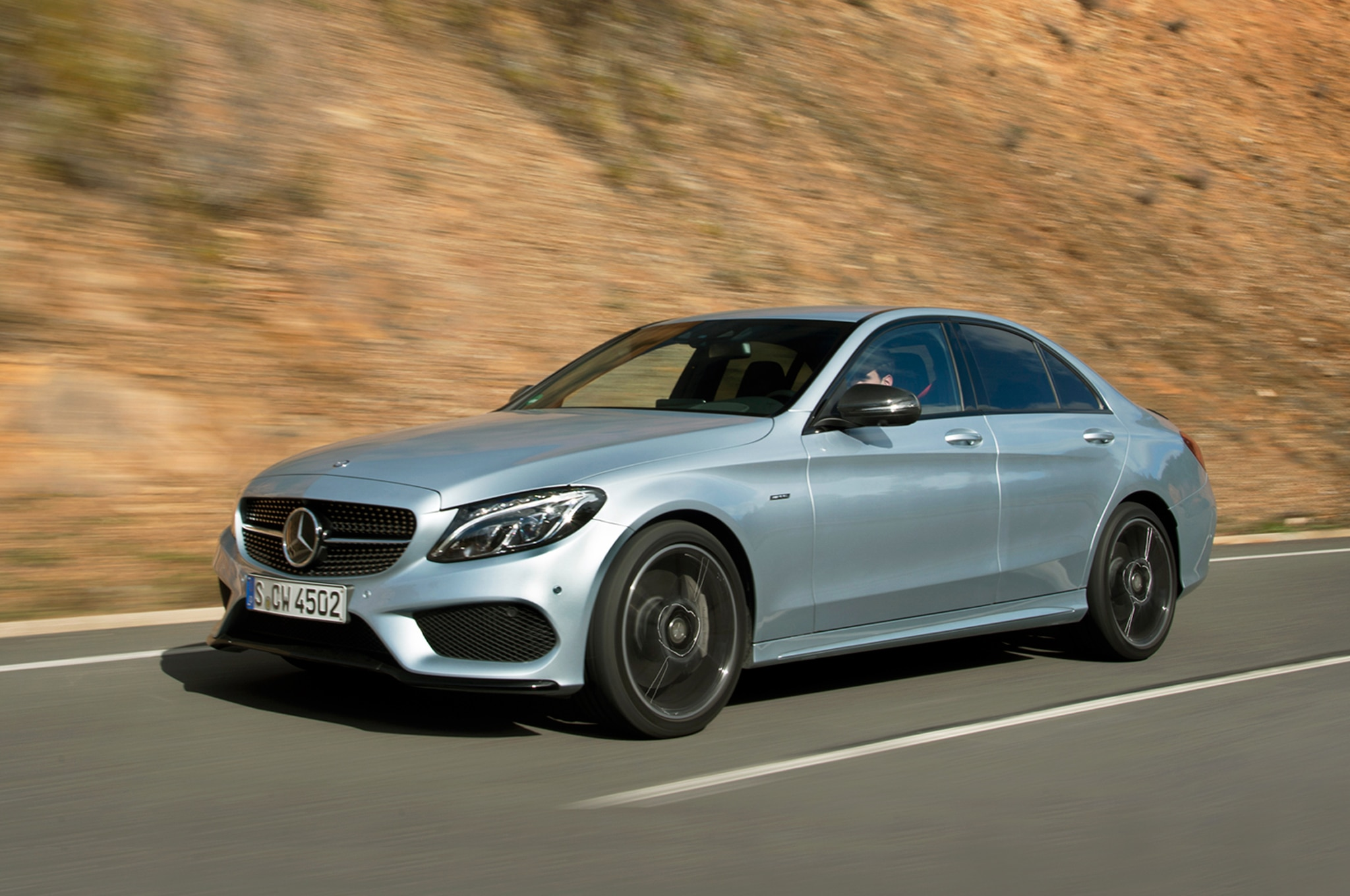 https://st.automobilemag.com/uploads/sites/11/2015/02/2016-Mercedes-Benz-C450-AMG-4Matic-front-three-quarter-in-motion-031.jpg