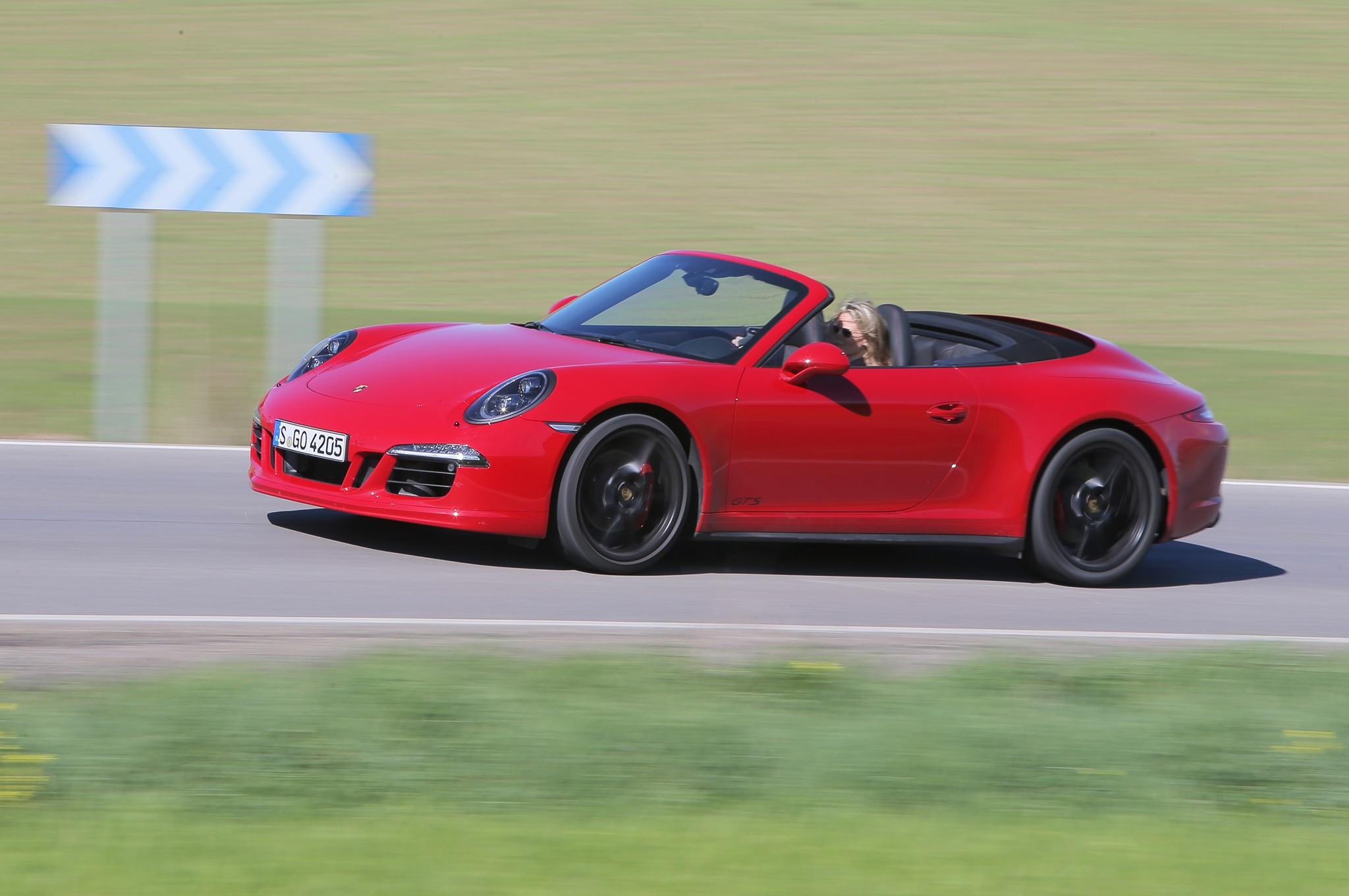 2015 Porsche 911 GTS Cabriolet Front Three Quarter In Motion 03
