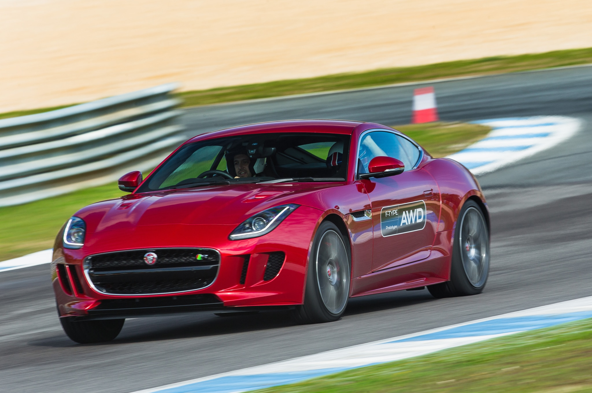 2016 Jaguar F Type R AWD Front Three Quarters In Motion 03