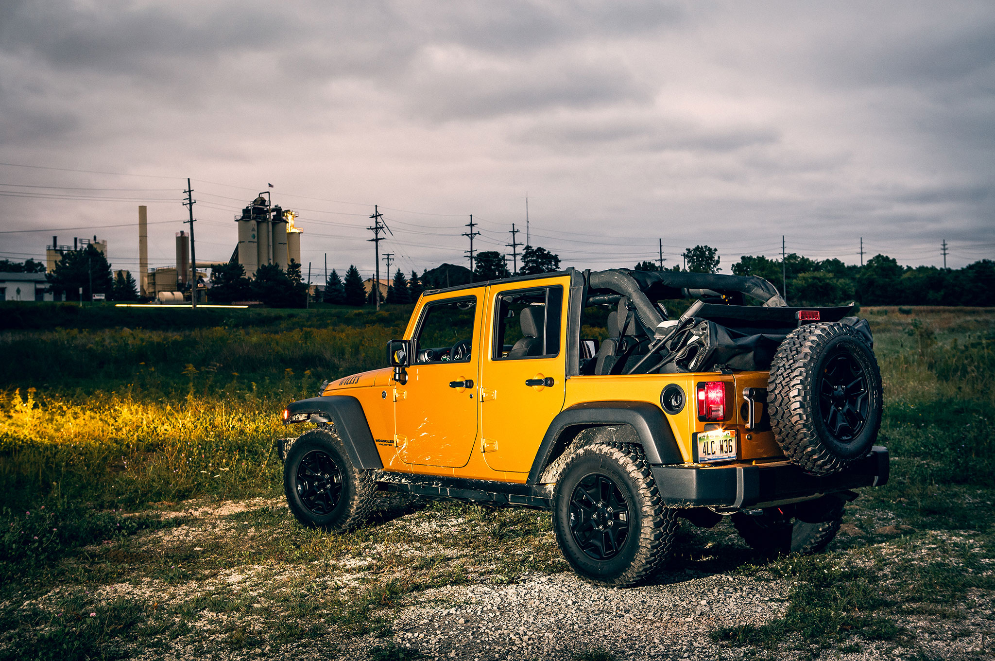 2014 Jeep Wrangler Unlimited Willys Wheeler Rear Three Quarter View1