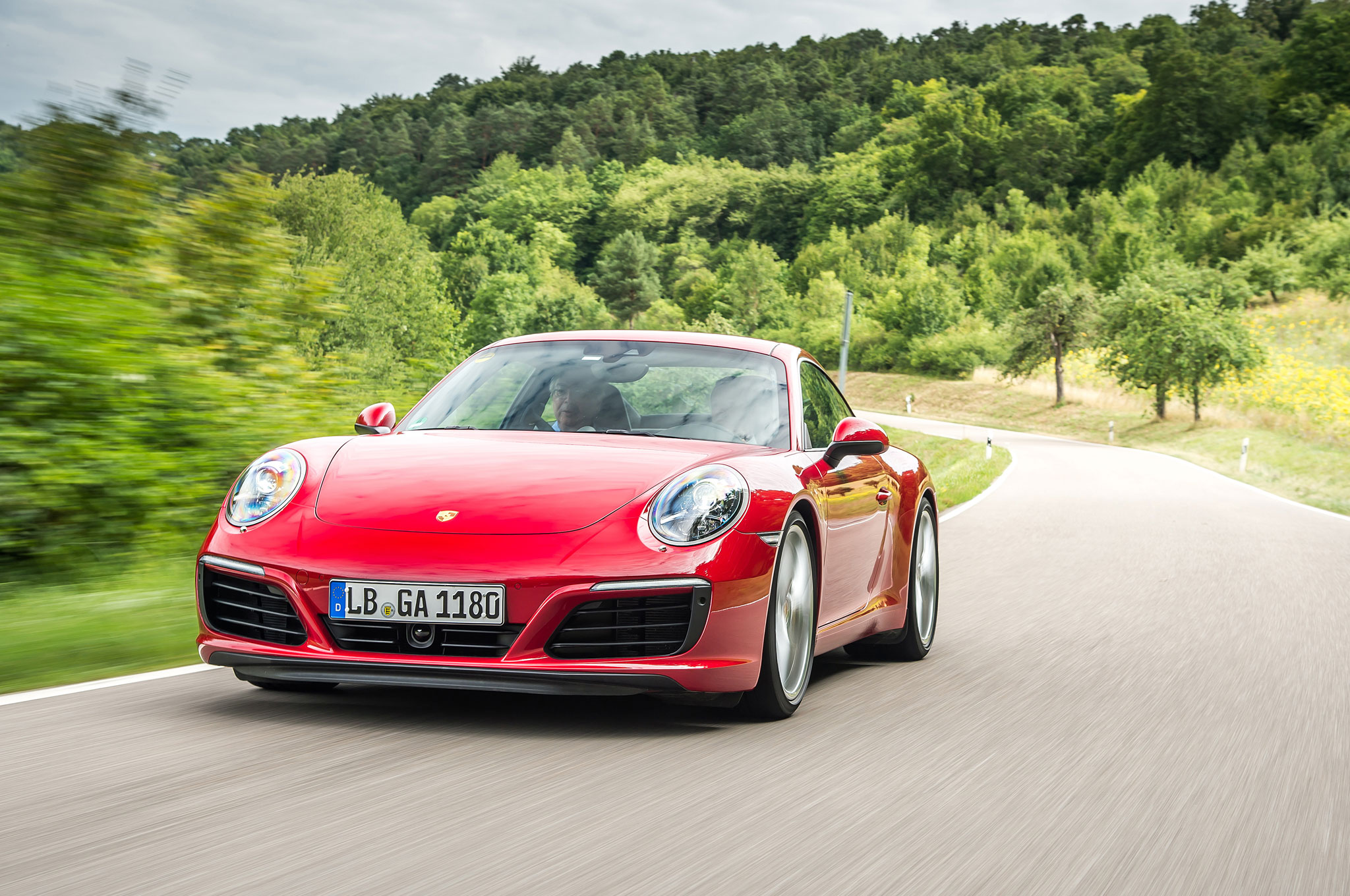 2017 Porsche 911 Carrera S Front Three Quarter In Motion 01