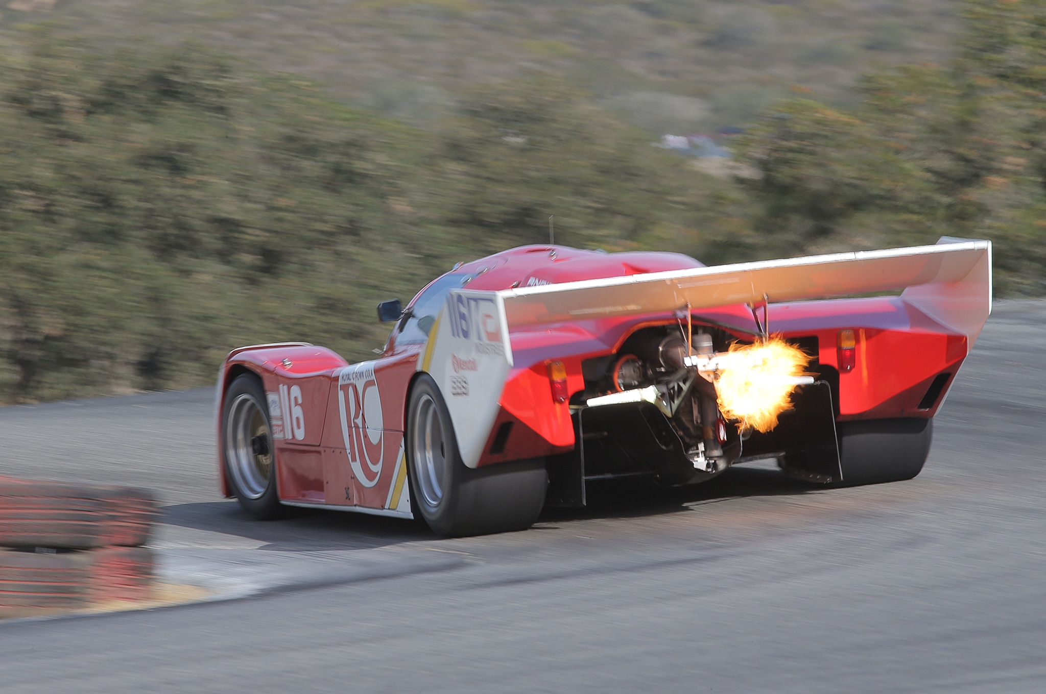 3. A 1986 Porsche 962 spits flame at the top of the Corkscrew.