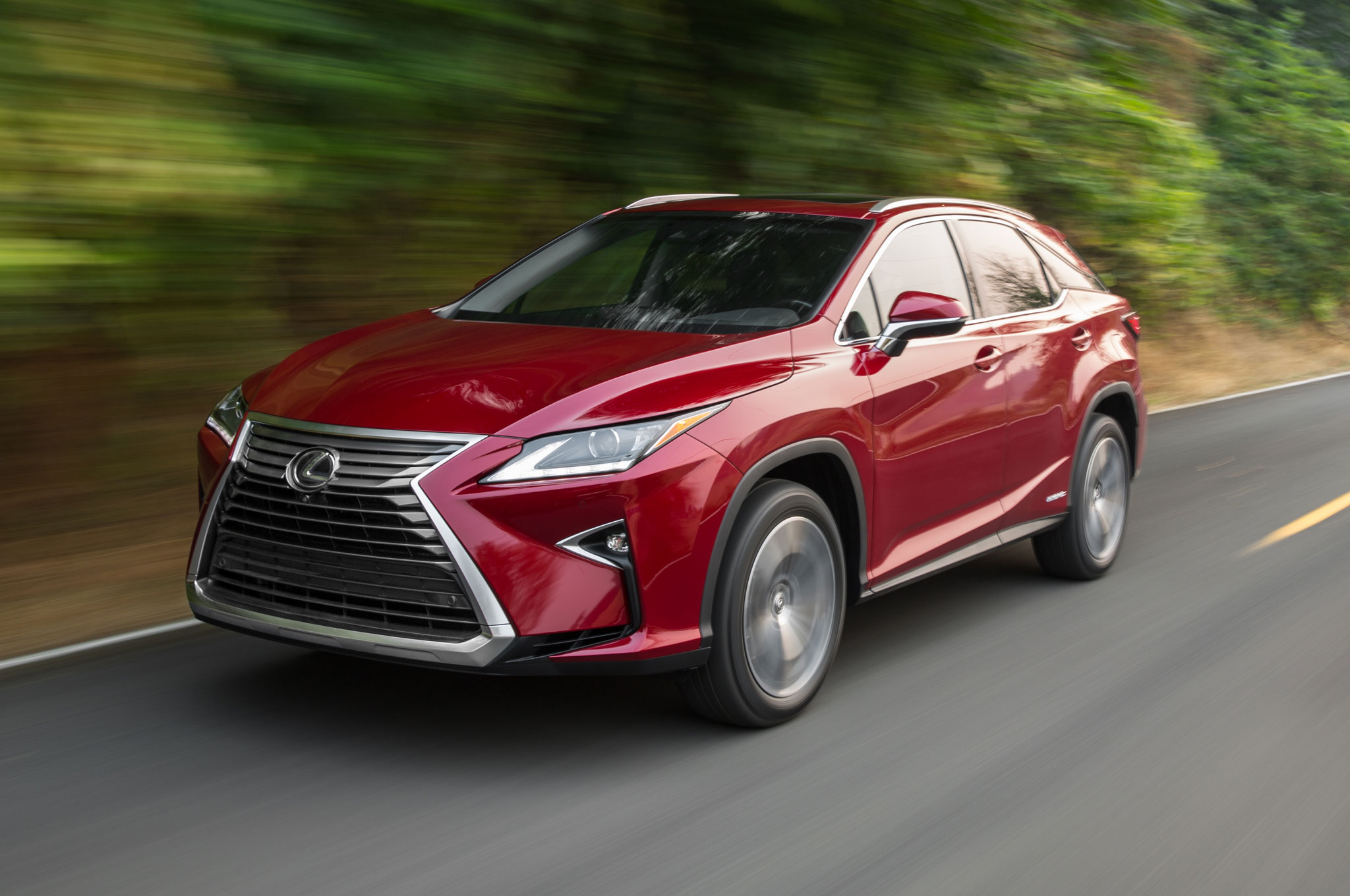 2016 Lexus RX 450h Hybrid Front Three Quarter In Motion 03