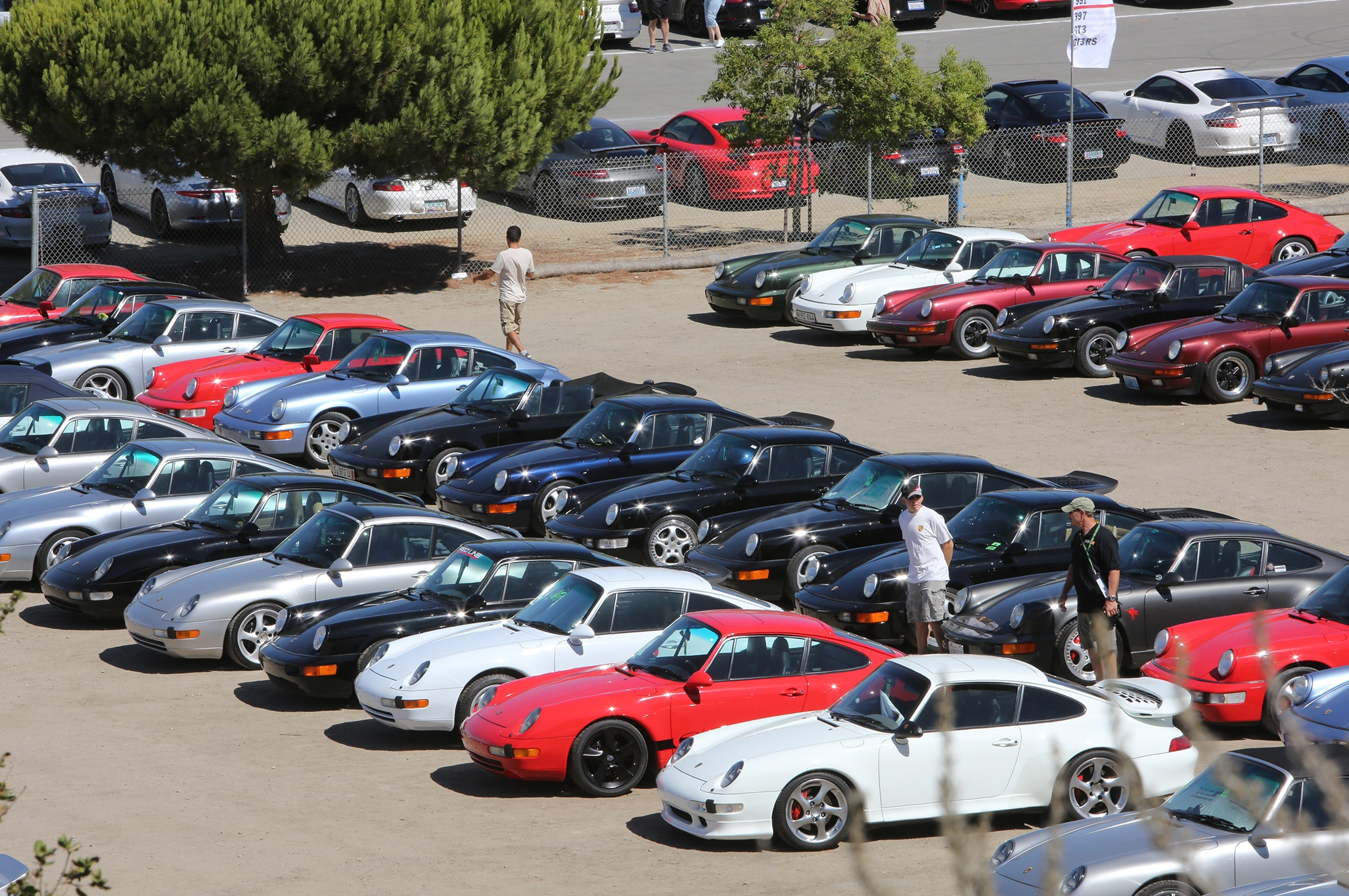 25. The parking lot was jammed with Porsches ranging from 356s to 991s. Smallest parking lot? The one with the front-engine sports cars.