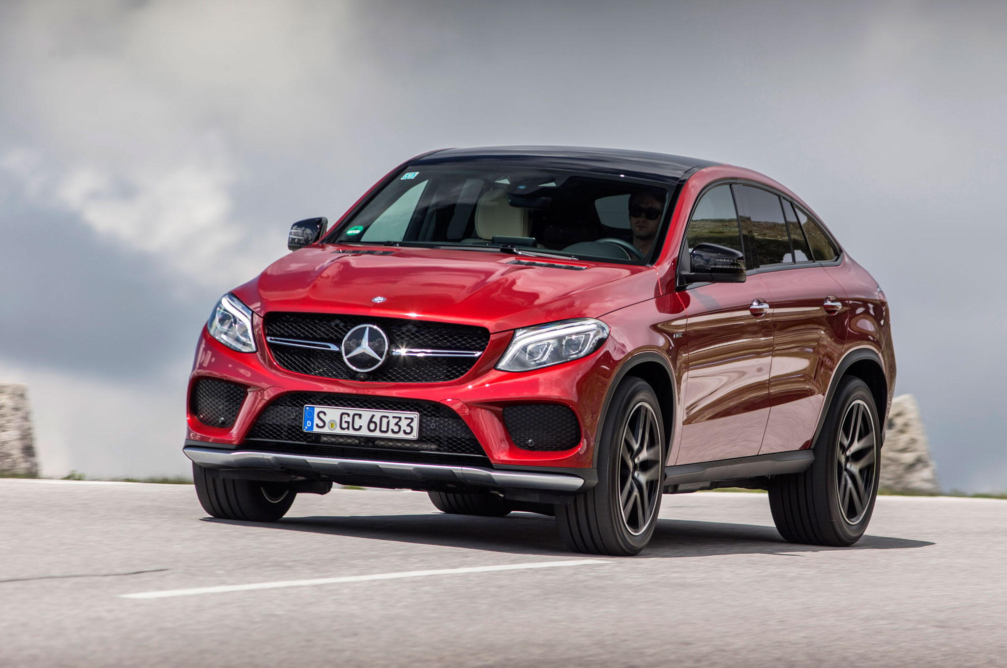 https://st.automobilemag.com/uploads/sites/11/2015/10/2016-Mercedes-Benz-GLE450-AMG-4Matic-Coupe-front-three-quarter-in-motion-09.jpg