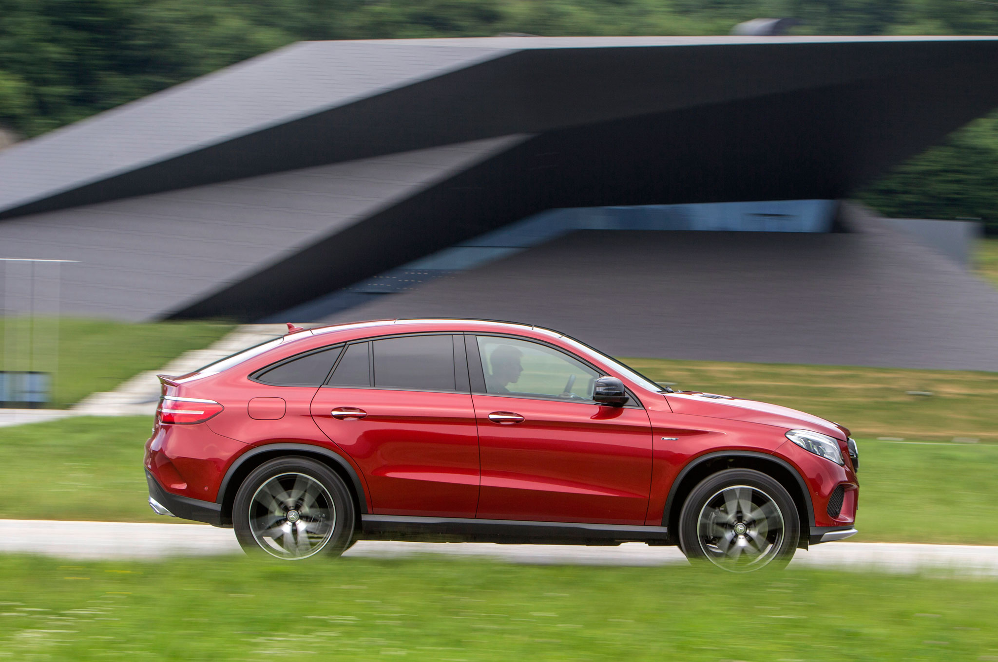 2016 Mercedes Benz GLE450 AMG 4Matic Coupe Side Profile In Motion 03