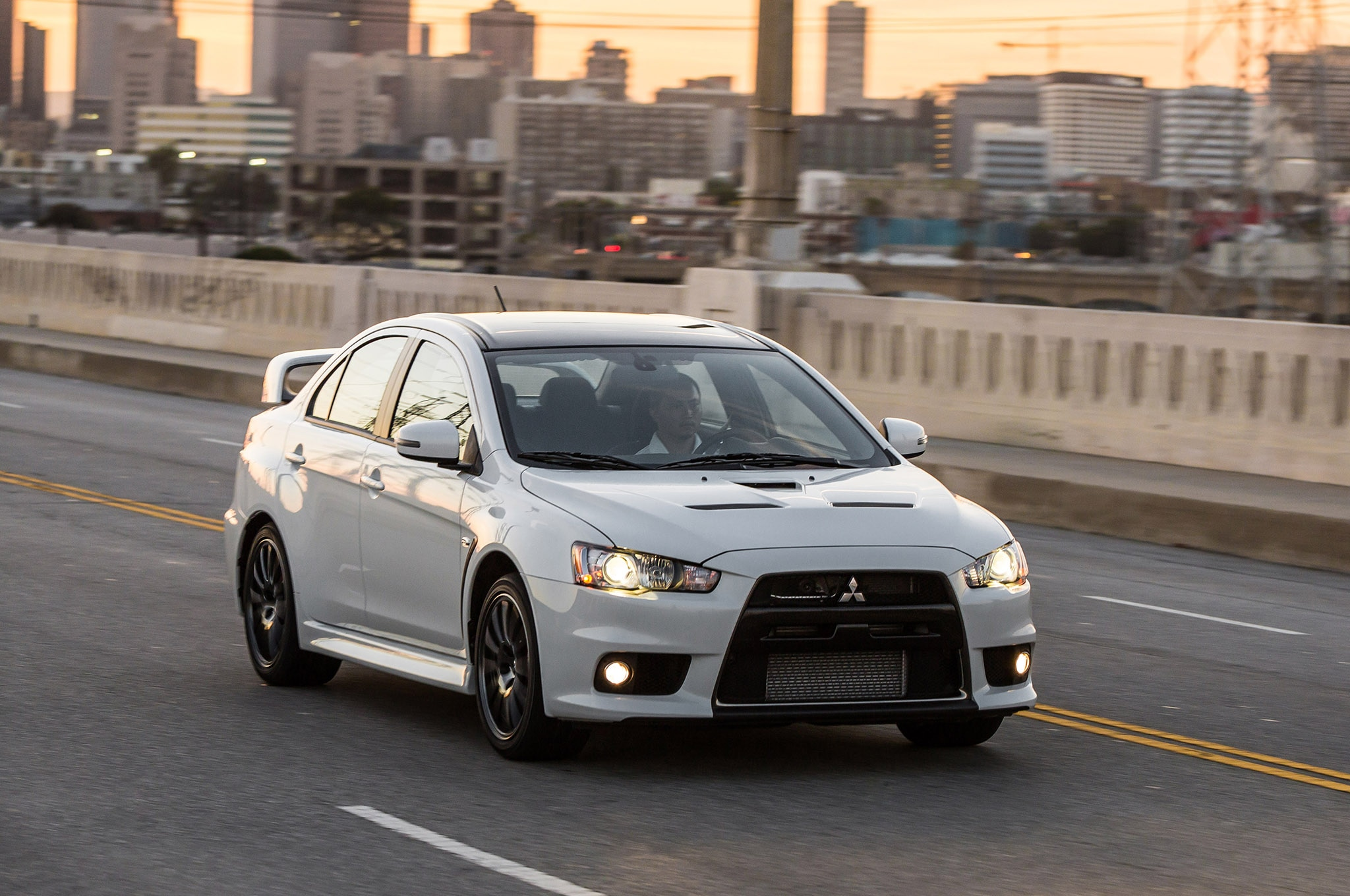 first mitsubishi lancer evo final edition auctioned for charity