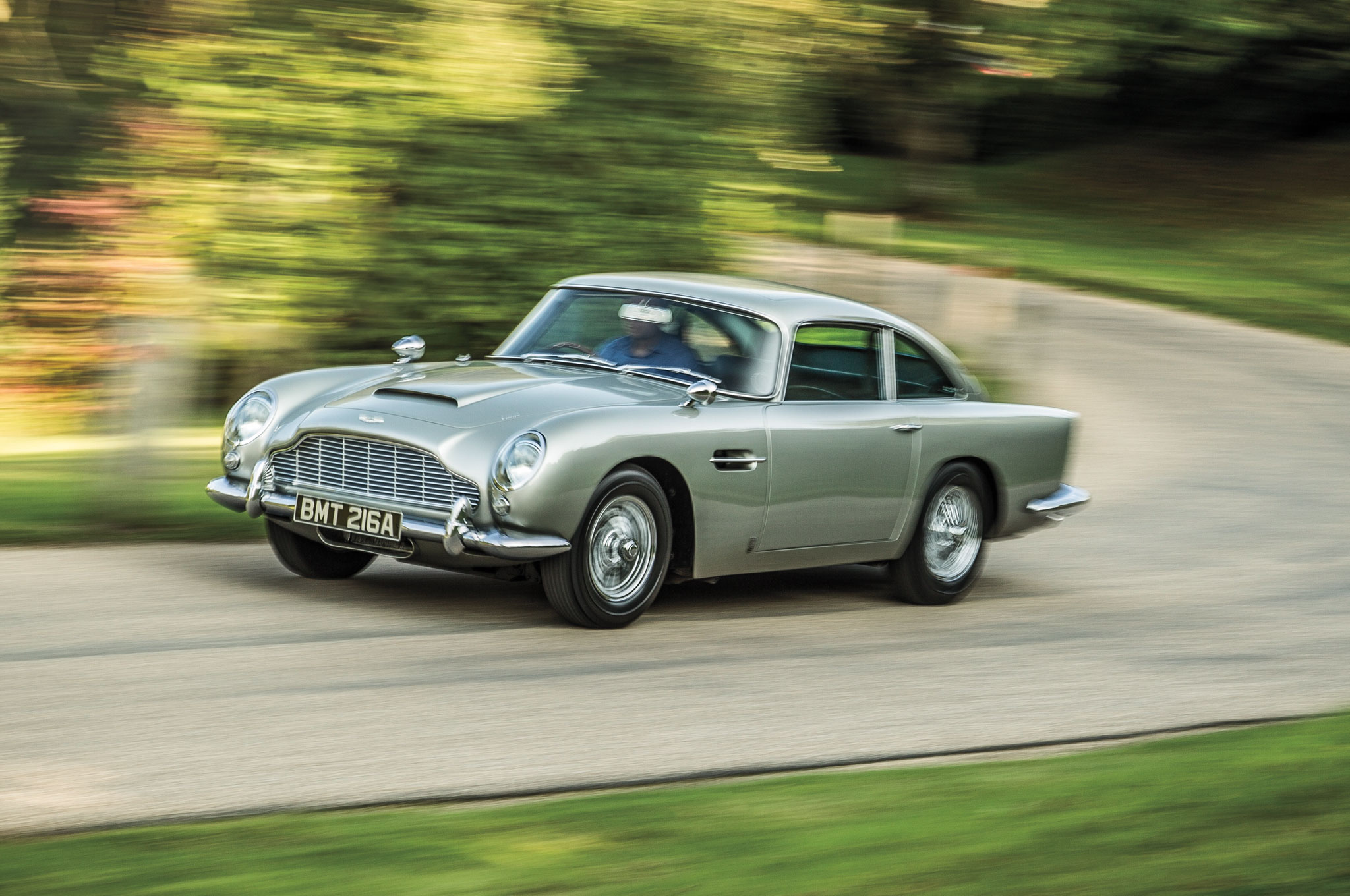 The DB5 started it all in '64. Even after a slew of other Astons, it's the one that makes us swoon like a Bond girl. It's just so damn attractive, from its Silver Birch paint to its dapper interior.