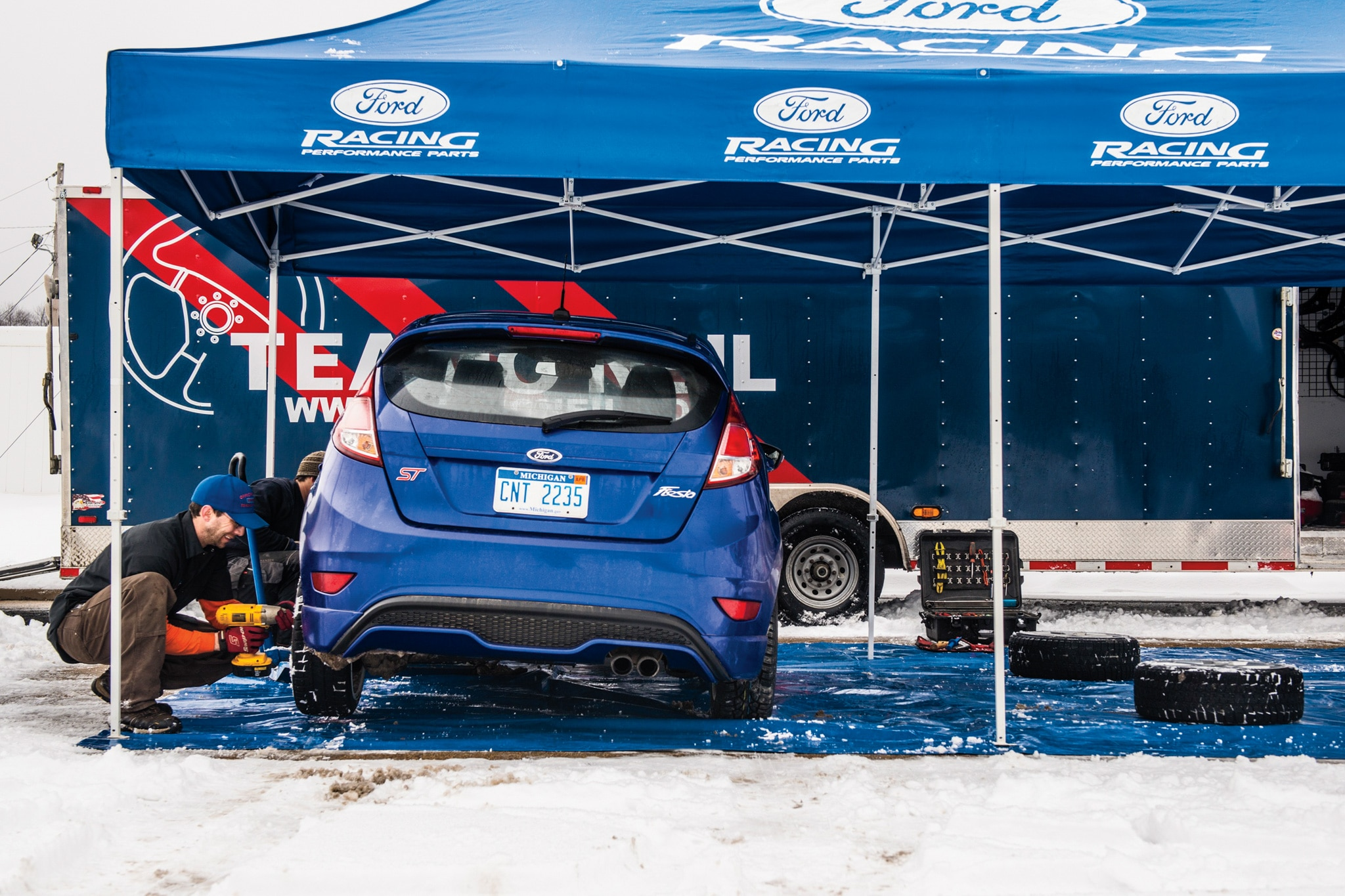 Our stock Fiesta ST needed only upgraded wheels and tires to conquer a winter rally stage alongside its rally-prepped twin, below.