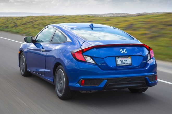 2016 Honda Civic Touring Coupe rear three quarter in motion 02
