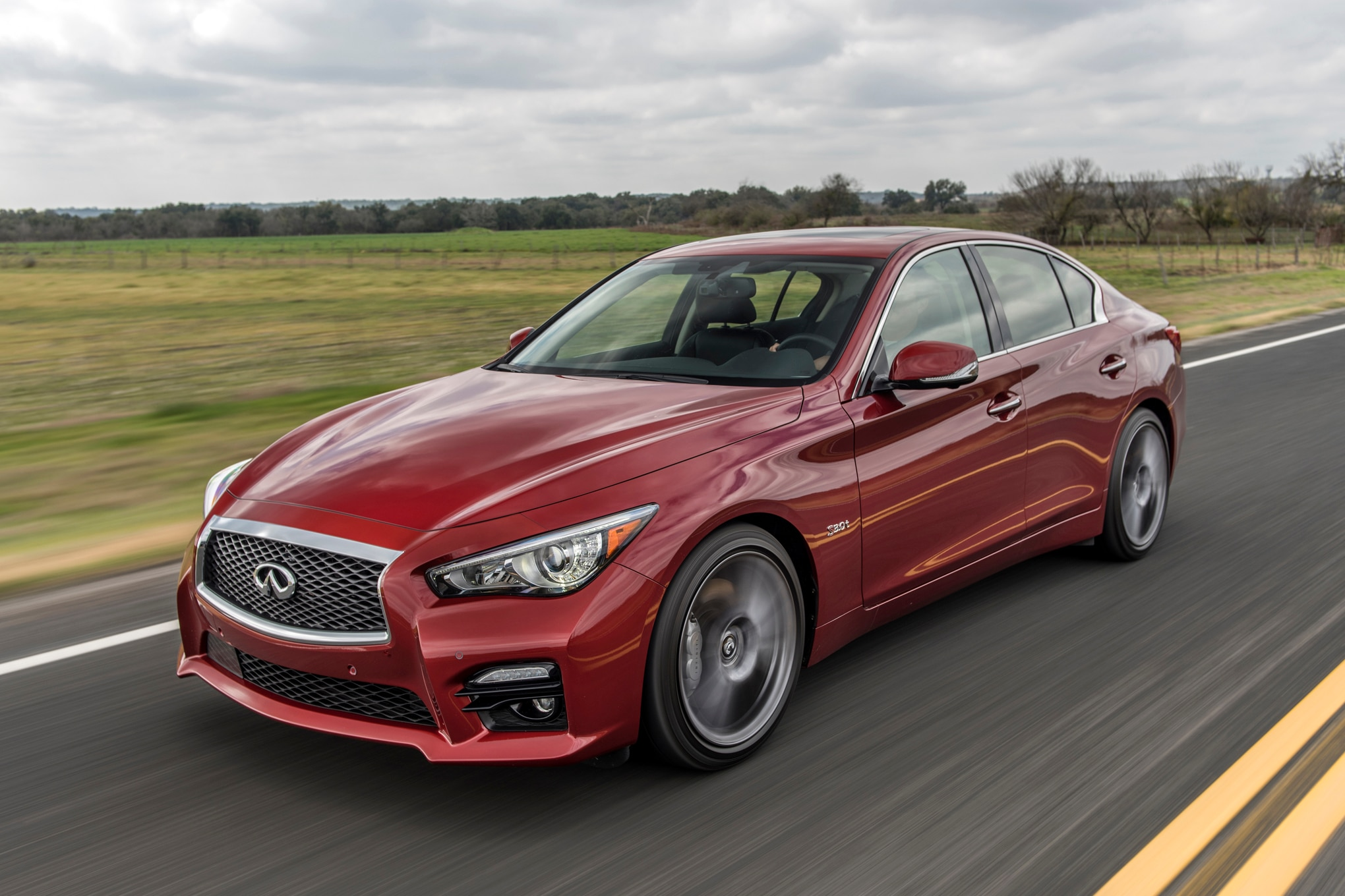 2016 Infiniti Q50 Red Sport 400 Front Three Quarters In Motion 03
