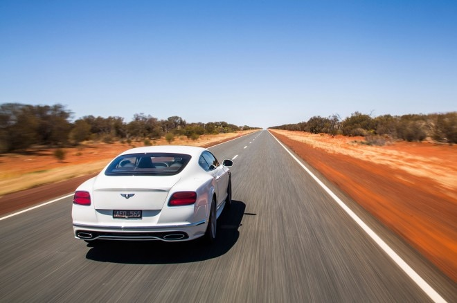 2016 Bentley Continental GT Speed rear three quarter in motion 05