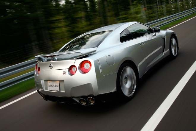 2010 Nissan GT R rear three quarter in motion 01