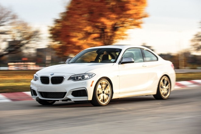 2014 BMW M235i front three quarter in motion 01