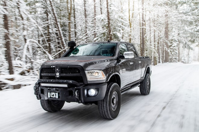 2015 AEV Prospector Ram 2500 Power Wagon Front Three Quarter In Motion 04