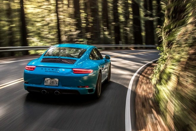 2017 Porsche 911 Carrera S rear three quarter in motion 01